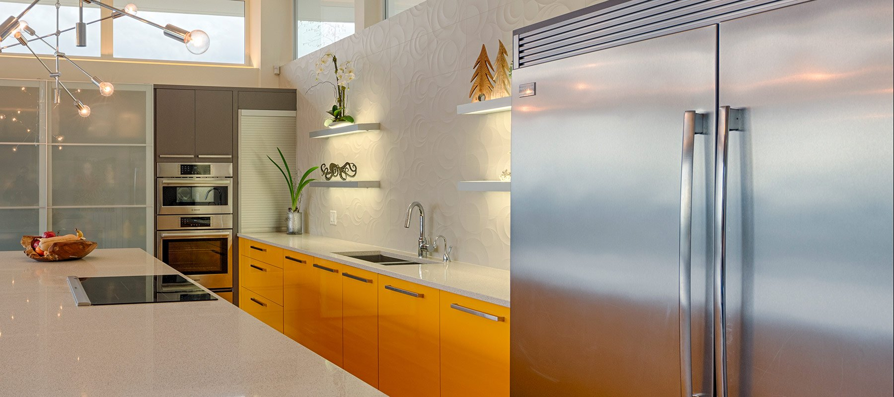 Custom Kitchen with Yellow Cabinetry and Dimensional Tile Backsplash